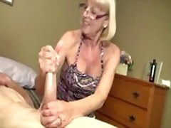 Horny granny enjoys buffing the nob