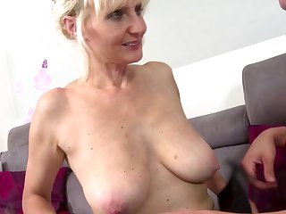 Blonde mom with big tits takes young dick