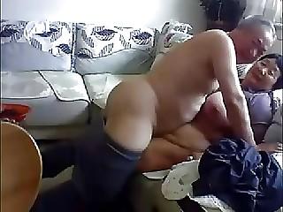 Mature Chinese pair fucks at home