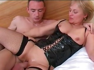 Juicy mother on the bed