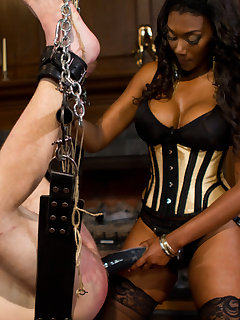 <!–-IMAGE_COUNT-–> of Pretty ebony pinches slave's dick and fucks him with dildo