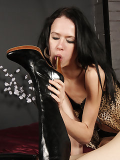 12 of Sophie is amused when her slave girl lick her boots