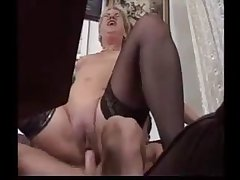 Germany Granny in stockings seduces a younger boy